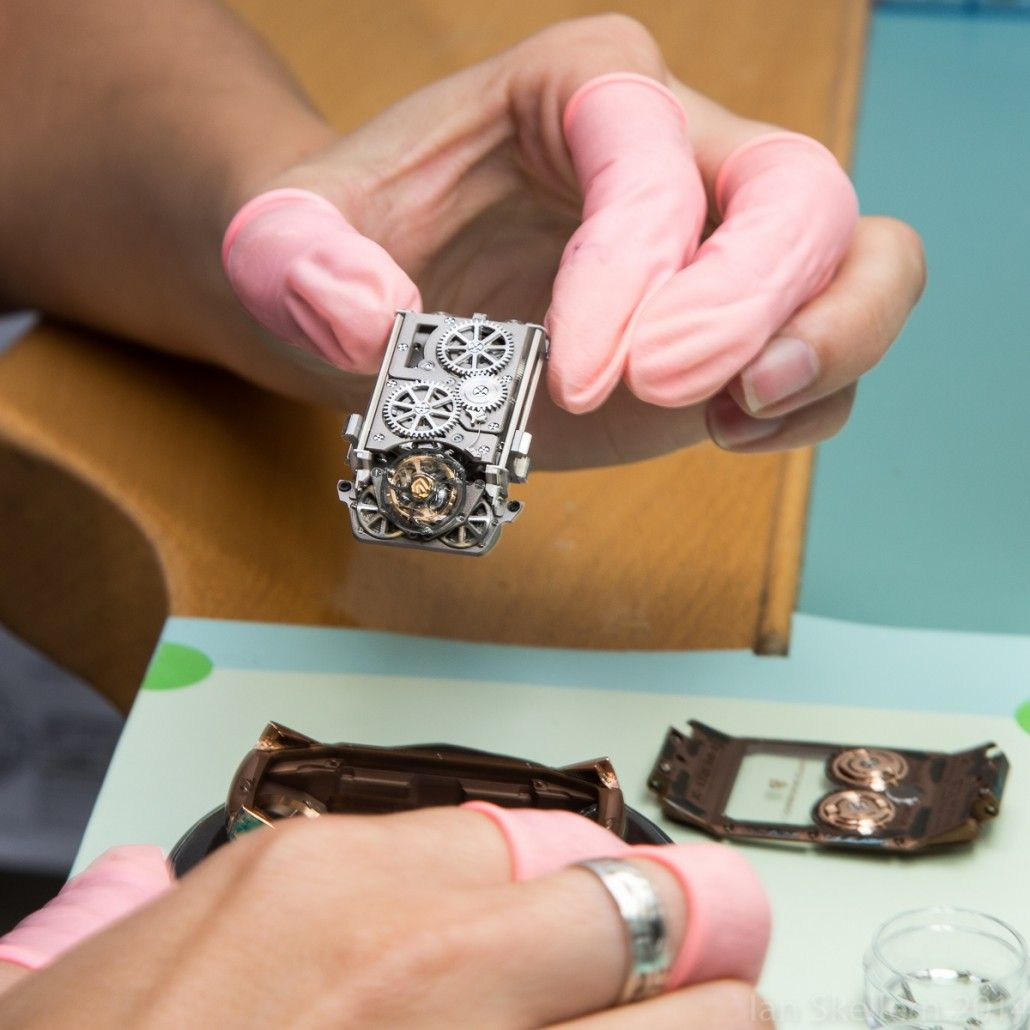 Carefully placing the movement of the Christophe Claret X-TREM-1 into its case from the back