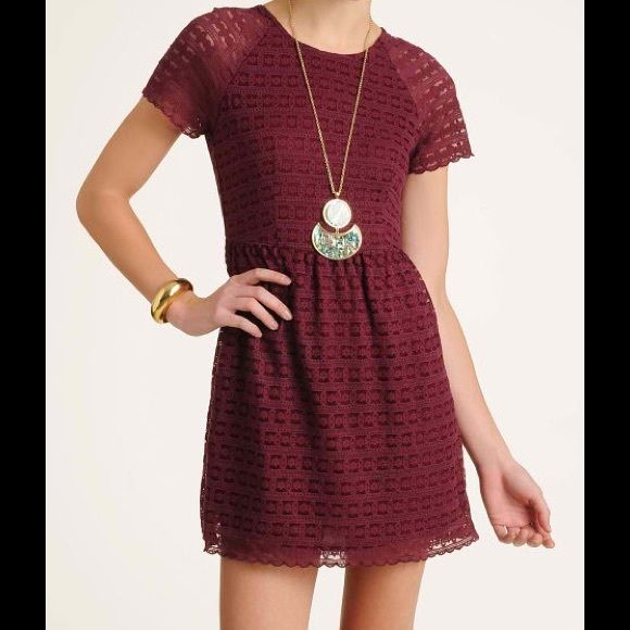 Free People Candy Woven Lace Dress Or Tunic Free People Women's Candy Lace Dress This dress from Free People features an intricate candy lace design that gives a timeless, darling look to any holiday party-goer. Short sleeve dress: Candy lace design; Back zipper closure; Burgundy. New with boutique price tags only!  Shell is 70% cotton and 30% nylon, and the lining is 100% rayon. Free People Dresses