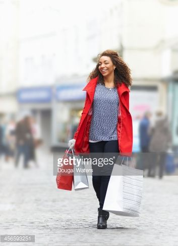 Stockfoto : Woman on shopping street with gift bags.