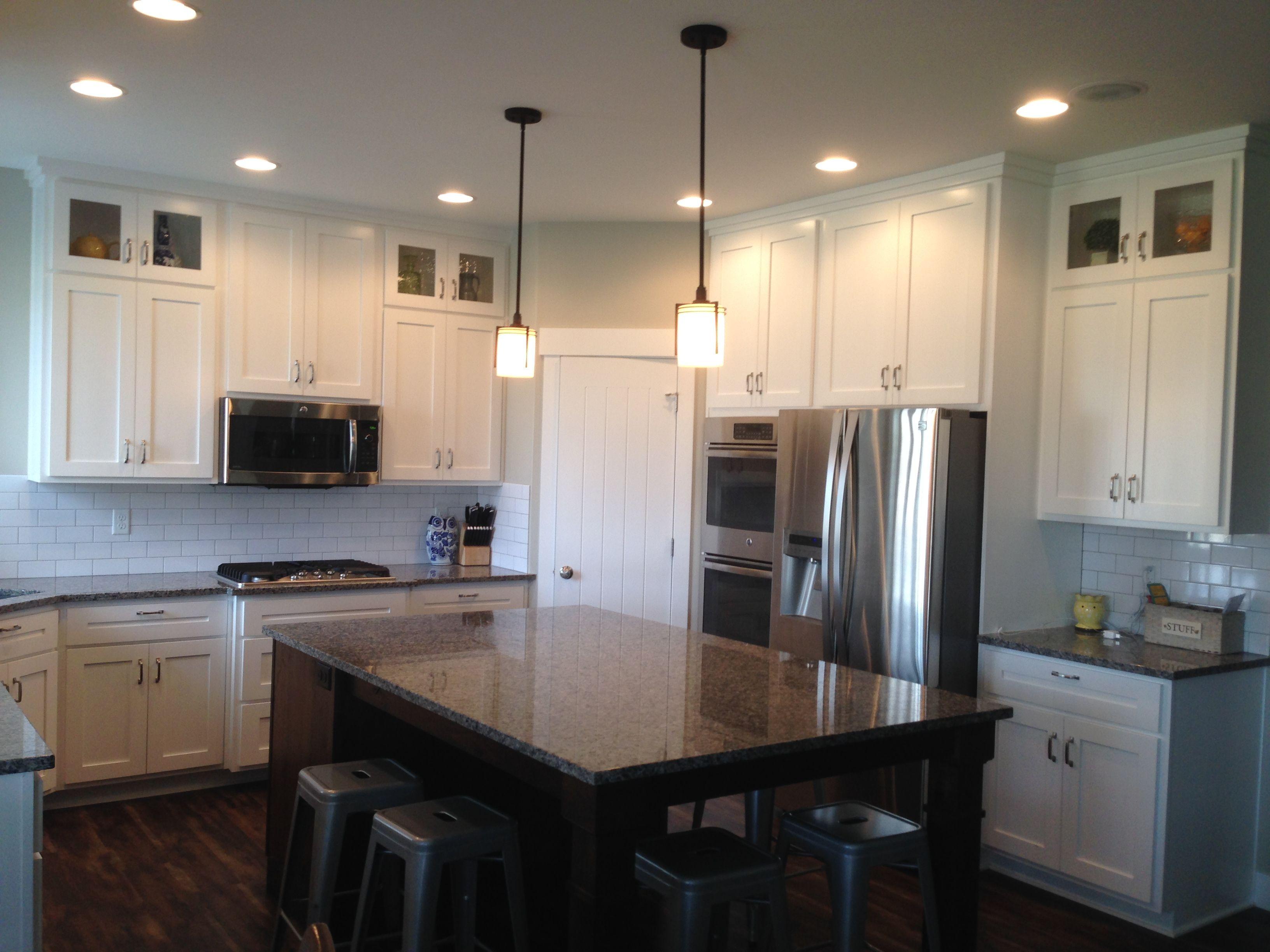 Kitchen ideas; white kitchen cabinets and a dark island to ...