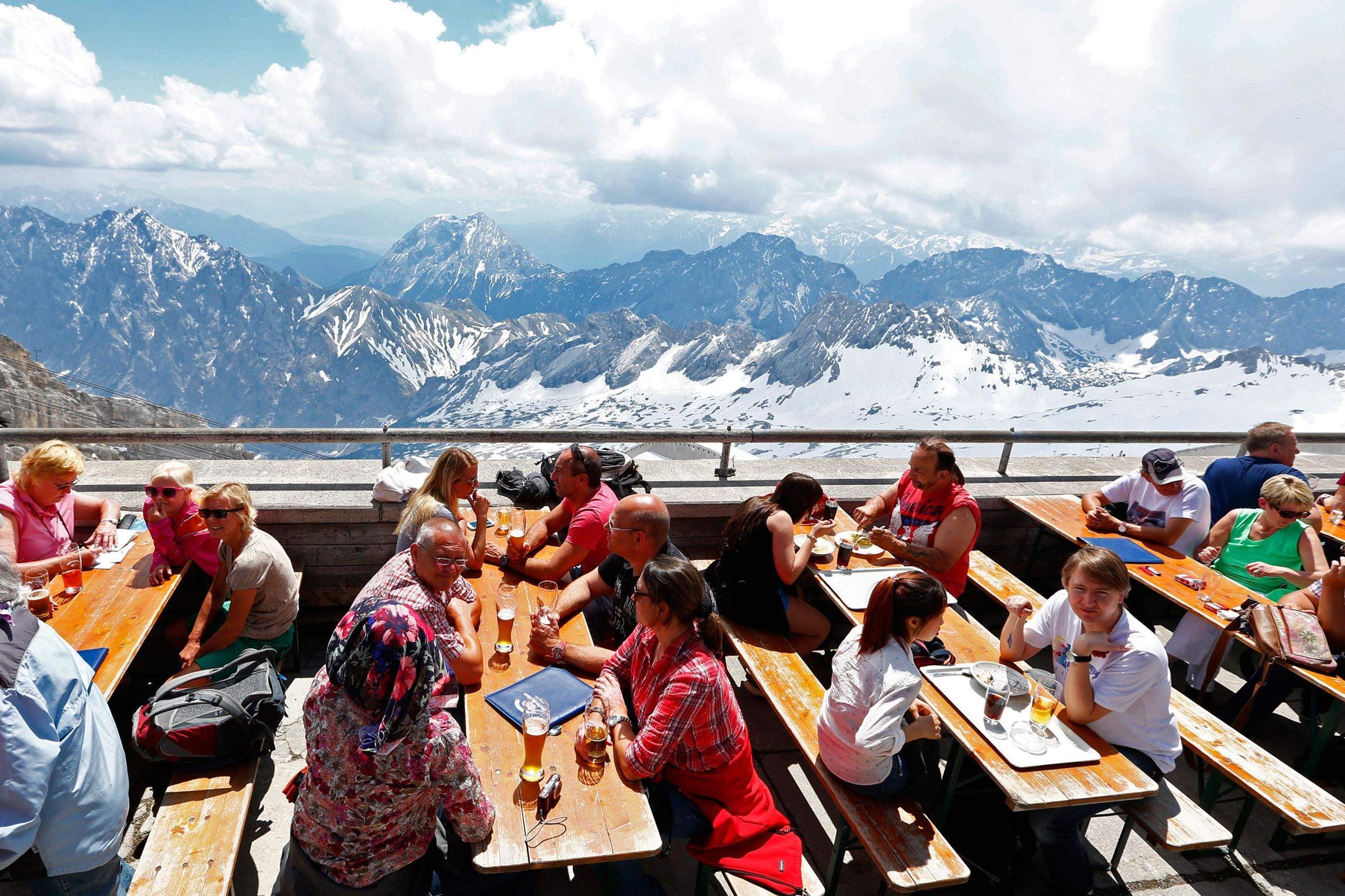 Grainau, Germany       Tourists enjoy sunny weather in Germany's highest beer garden atop of the 9,718 foot Zugspitze mountain in Grainau, Germany, on June 5.  2015