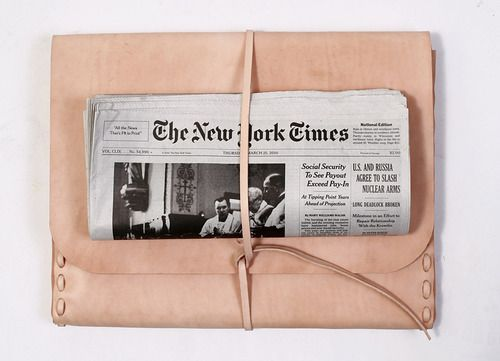 New York Journal tucked nicely underneath a leather strap. Anyone know what kind of carrier that is?