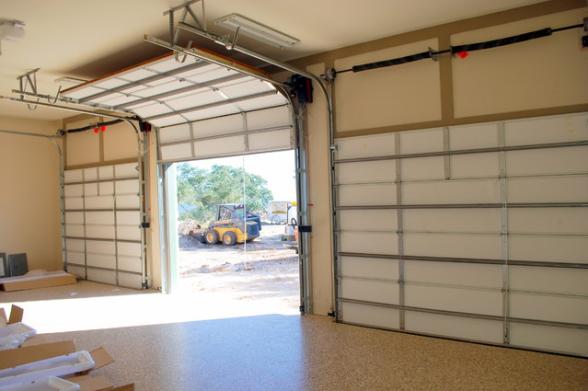 High Lift Garage Door Installation Austin Tx Garage Door Installation Garage Interior Garage Door Spring Repair