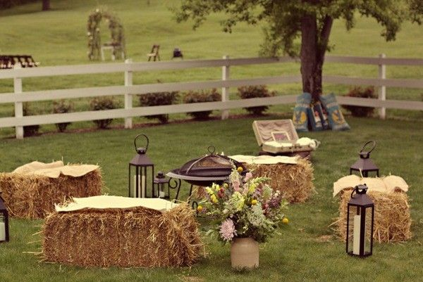 Cute seating around bonfire for wedding...unless they catch fire!   ...love the idea of sunset nuptials in field, then big bonfire reception with BBQ aglow, hot chocolate with baileys drinks, mason jars strung from trees, straw bale seating around home made tables covered in cheesecloth...big bonfire with smores and sparklers!