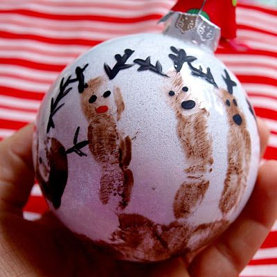 This would be a cute idea to do with the kids.  Reindeer Christmas Ornaments - - handprint on glass bulb