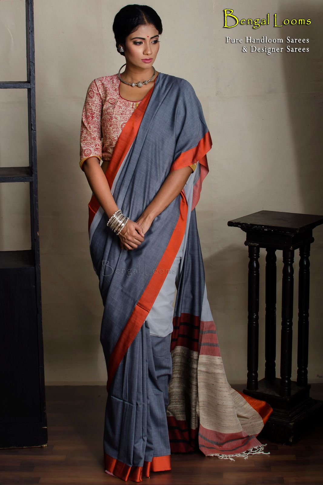 c3edc0113a Pure Handloom khadi soft cotton saree with bright woven satin border and  pure tussar aanchal in Grey, Steel Grey and Orange combination.