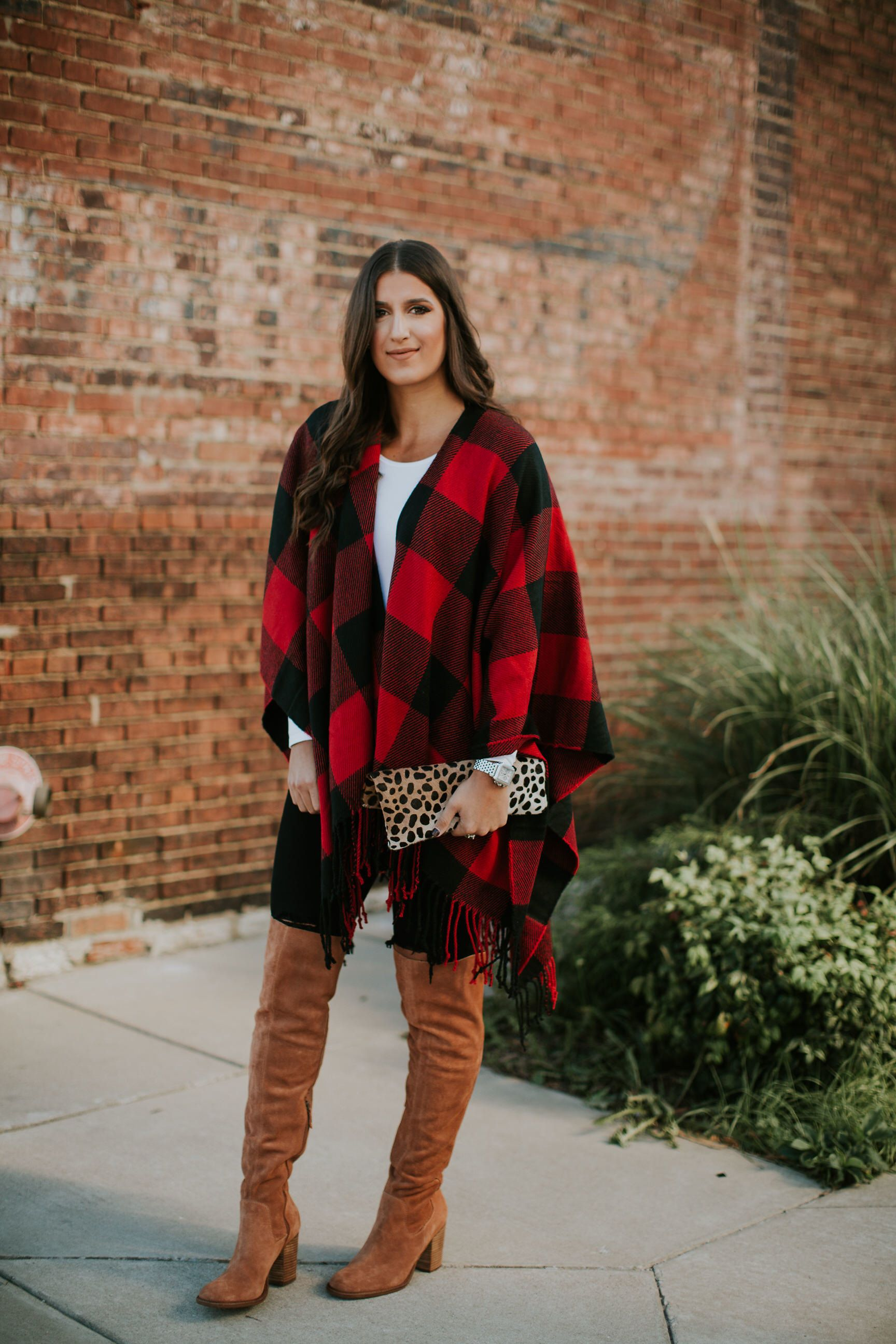 c11c2482018 White sweater+black skinny jeans+cognac over the knee boots+red and black  plaid poncho+leopard print clutch. Fall Casual Outfit 2017