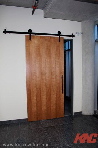 CFT-202-BP Sliding Door Kit is used here in an office building in Calgary, Alberta to create a modern look and feel