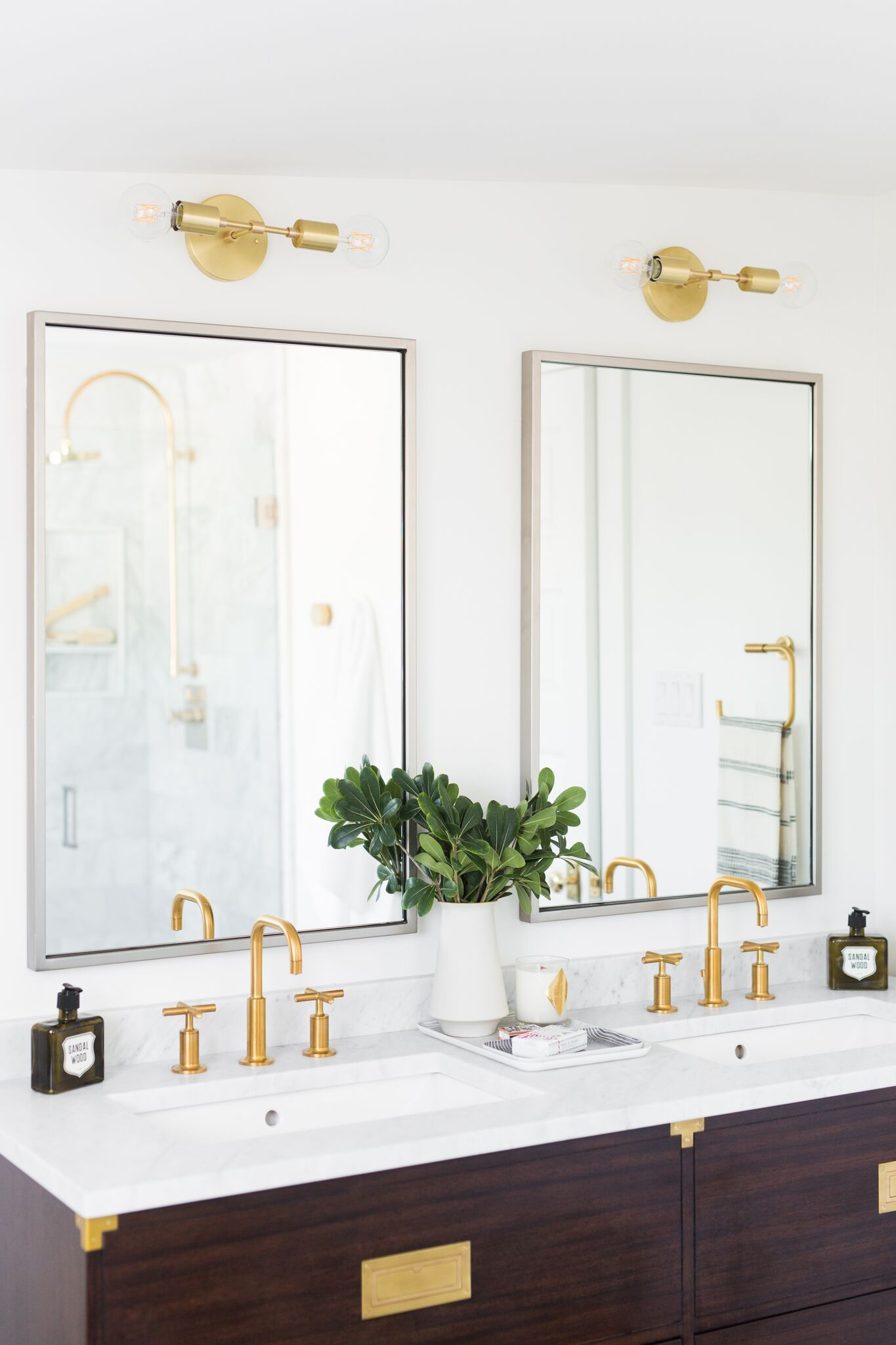 Gold Light Fixtures Above The Double Mirrors Gold Light Fixture