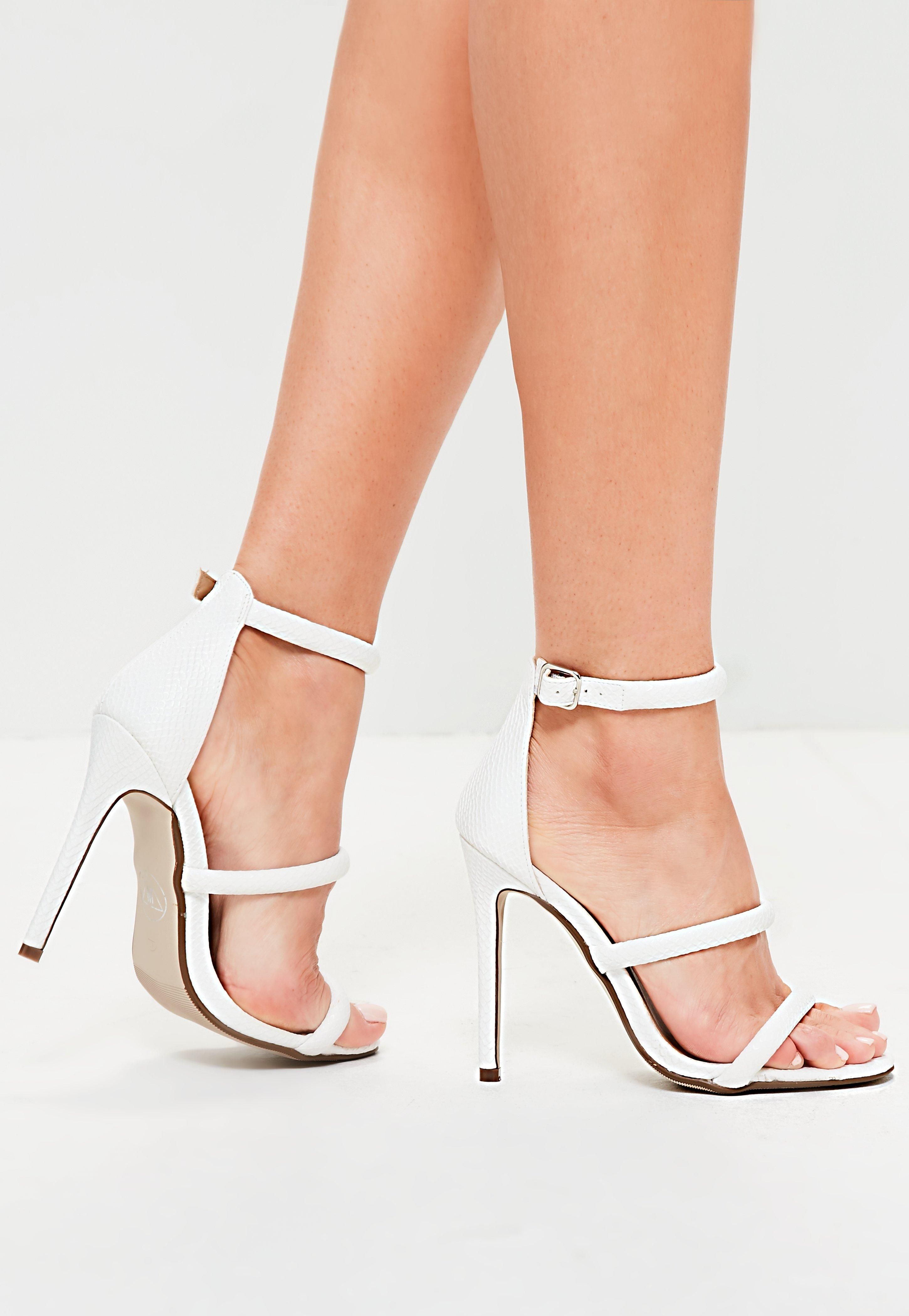282bade1a4b Every MG girl needs a killa  pair of white barely there heels and these  three strap beauts have all the boxes ticked.