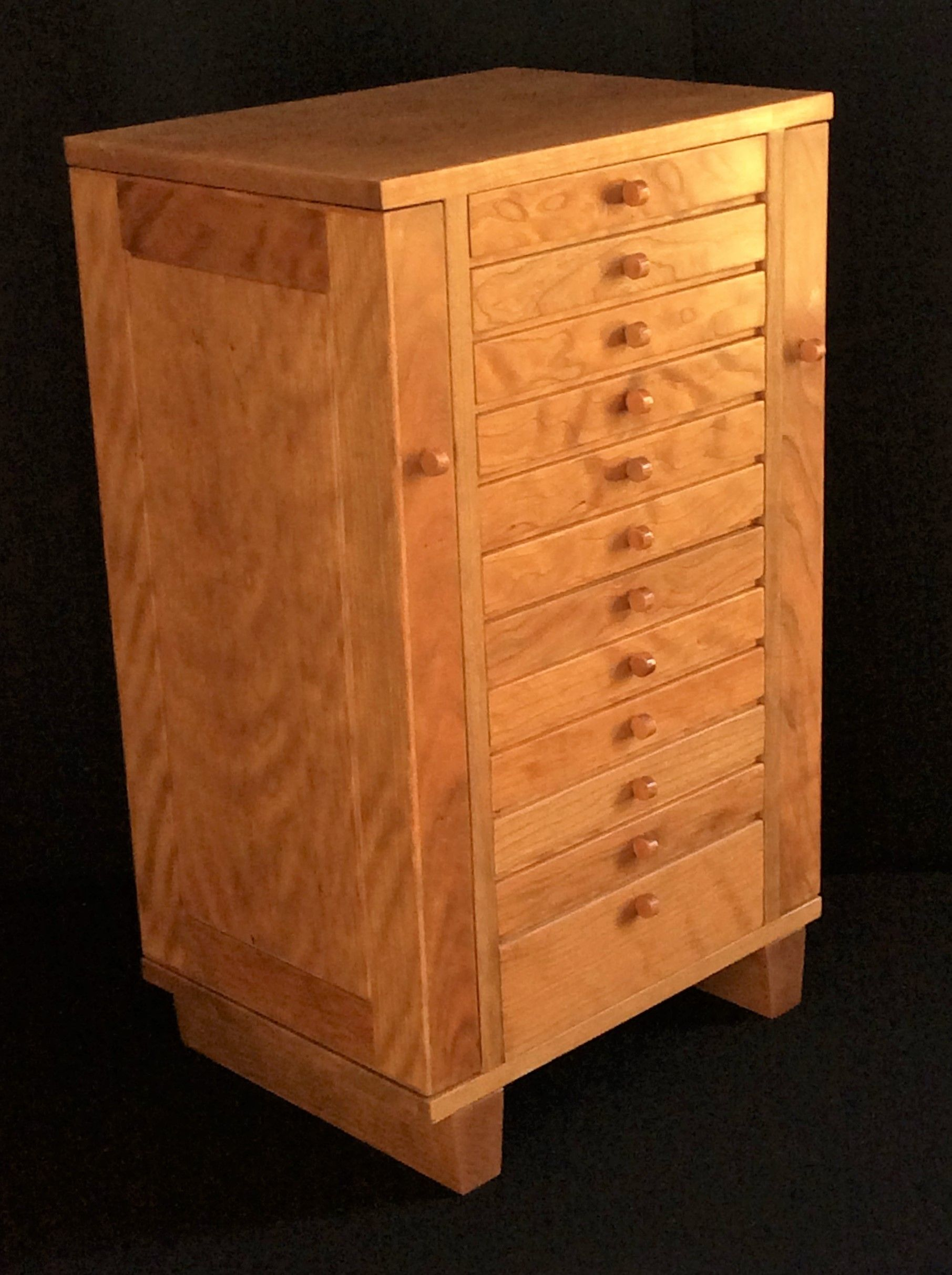A Small Jewelry Armoire. It Is Tall And Made From Solid Cherry Wood.