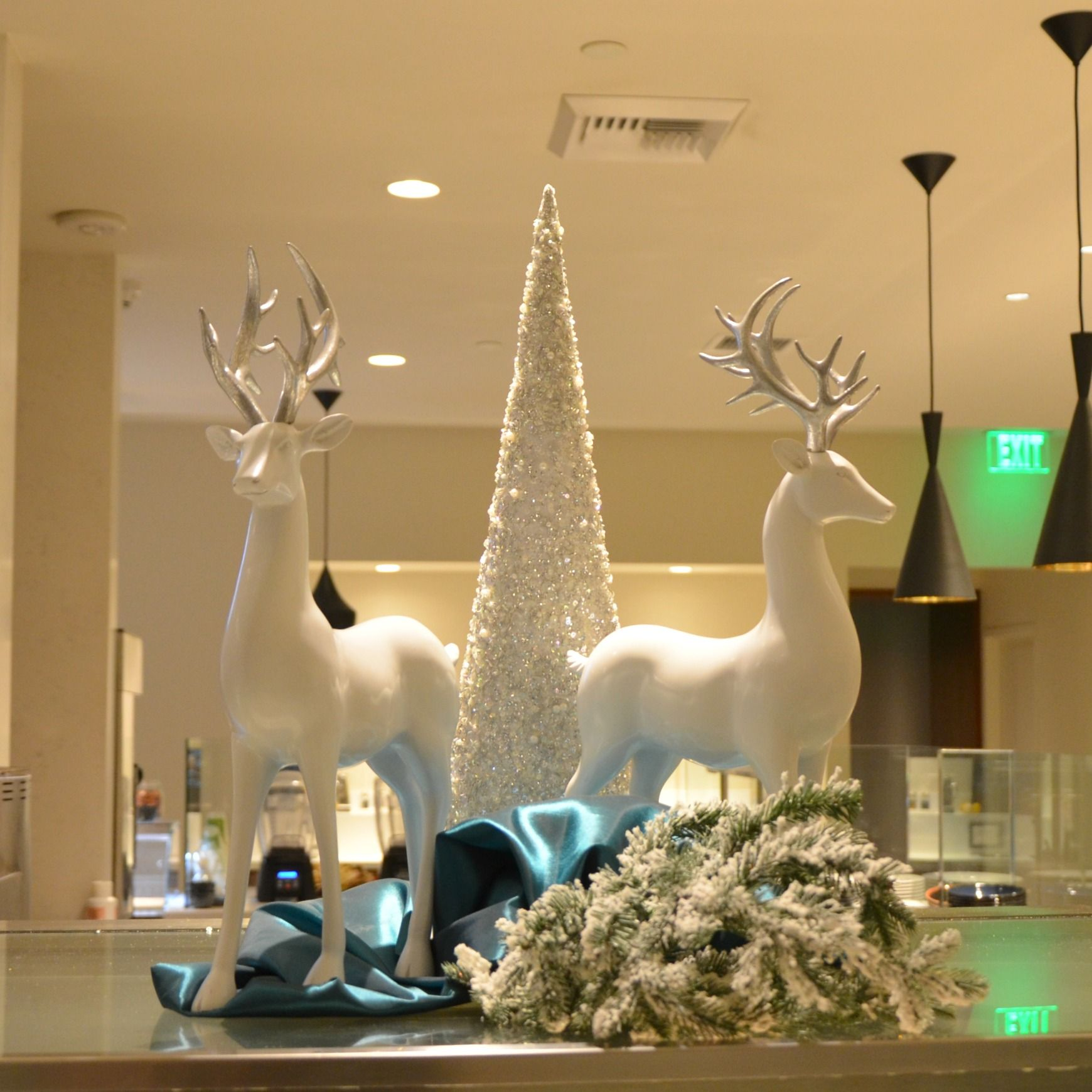 White And Silver Christmas Counter Decorations Commercial Christmas Decorator Christmas Tree Rentals Christma Silver Christmas Christmas Decorating Services