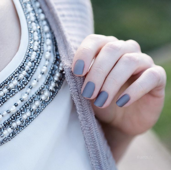 This fall, pair your chic style with the subtle sophistication of a gray matte 'chinchilly' manicure.