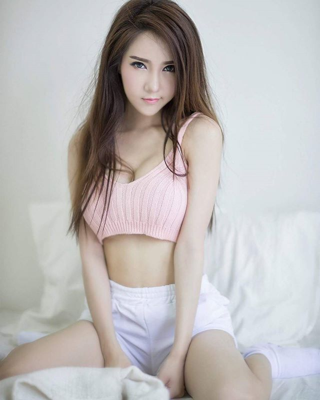 Cute Thai Girl Beautifully Posing For A Photograph On A -3874