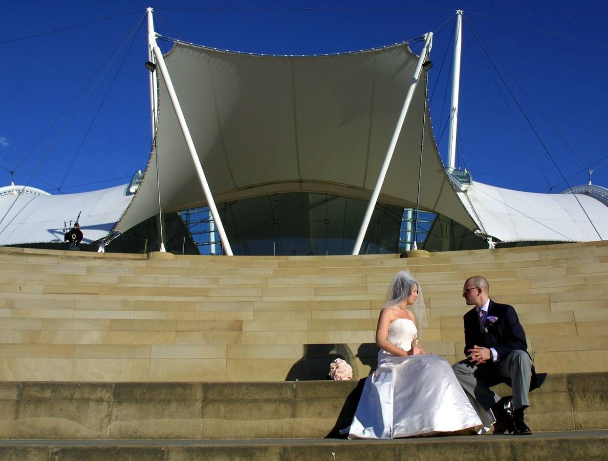 Bride & Groom having a moment on our amphitheater steps #Dynamicearth #Steps #Blueskies #Bride #Groom #Weddingdress