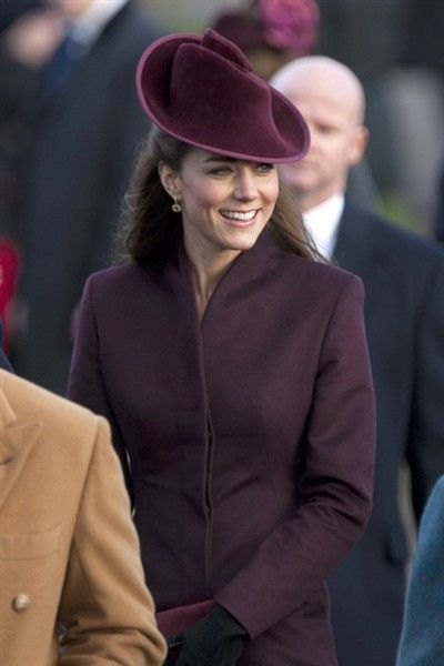 Kate Middleton going to church on Christmas day in a lovely plum hat.