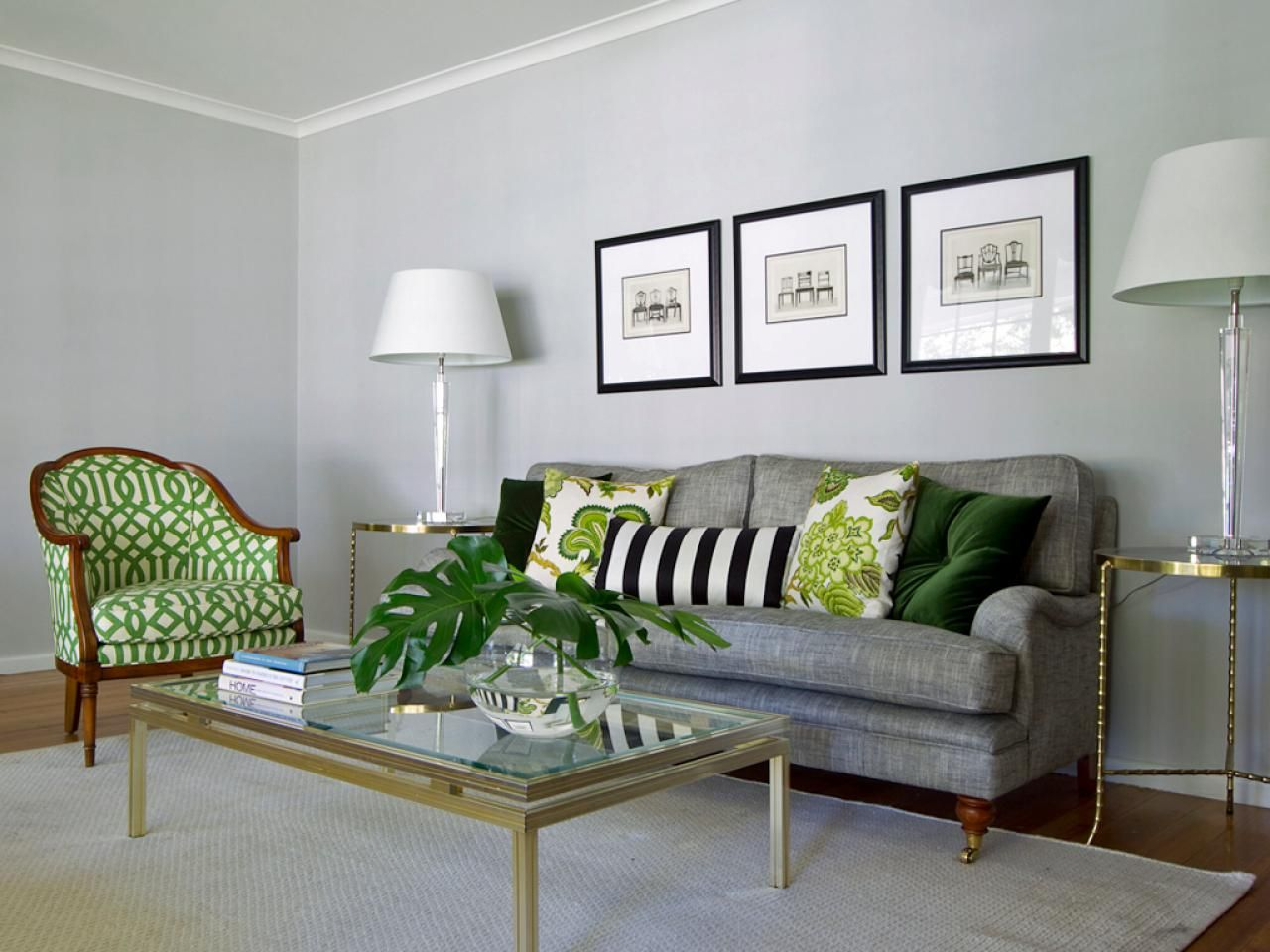 A Series Of Patterned Green Pillows Pop Against The Gray Sofa And Wall Color Glass Lamps On Slim Grey Furniture Living Room Living Room Grey Living Room Green
