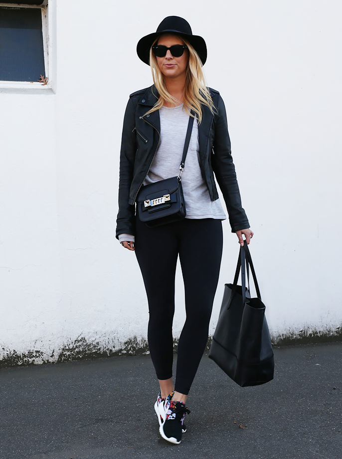 A long sleeved Tee, leather jacket and sneakers. Somewhat sporty with a  twist of