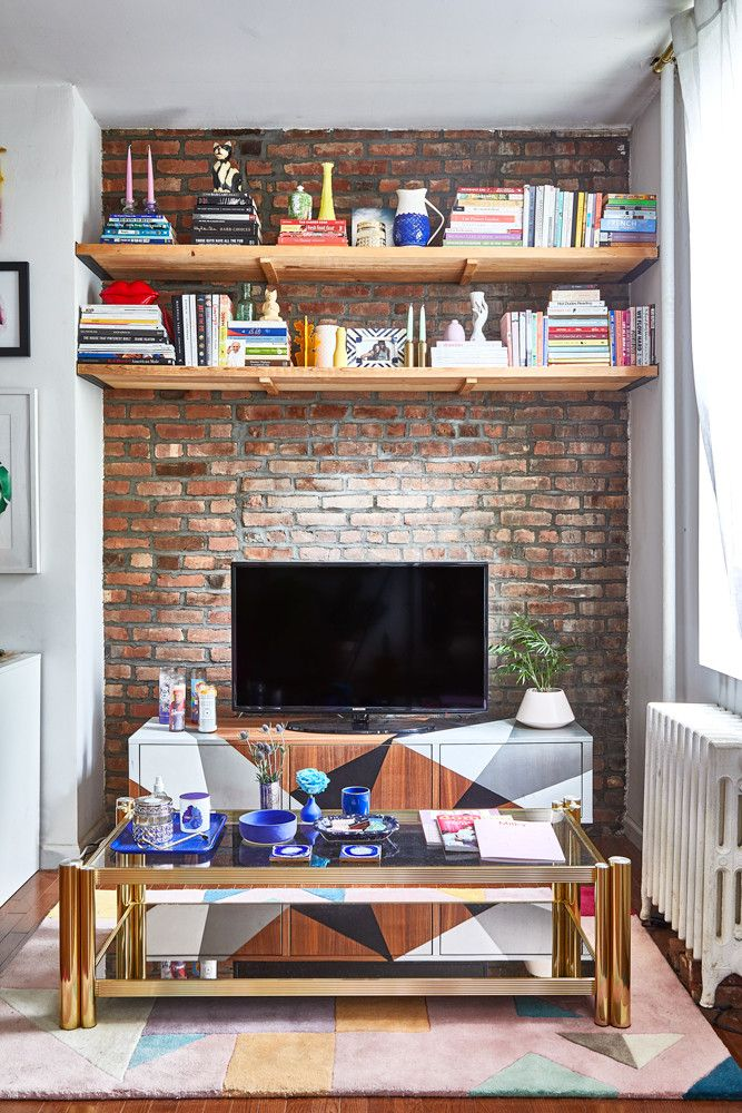 Social Media Editor Williamsburg Apartment Tour is part of Living Room Rug Shelves - Tour Domino Social Media Editor Alyssa Clough's Brooklyn apartment  Get inspired by the 650squarefoot space designed in a primary color palette and filled with unique, vintage, and small businessbought finds