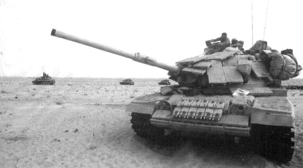 M60a1 Nicknamed American Express During Excercises In Saudi Arabia Prior To Desert Storm Tank Is Equipped In Explosi Tank Armor Patton Tank Armored Vehicles