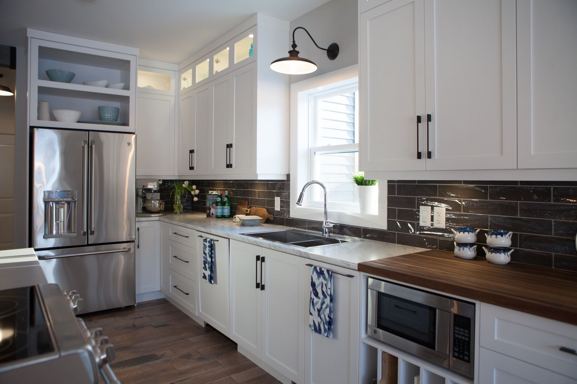 Classic White Kitchen With East Coast Feel This Custom Designed Kitchen Features White Cabinetry Bla Classic White Kitchen White Kitchen White Modern Kitchen