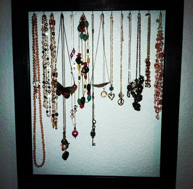 Another from YouTube. DIY picture frame necklace holder. Grab an old picture frame or buy a cheap one... This is a wooden one from hobby lobby. I painted it black (you could also add a design), then I took little gold hooks and twisted them into the wood and WALA. Quick and easy! Cheap too!#diy #jewelry