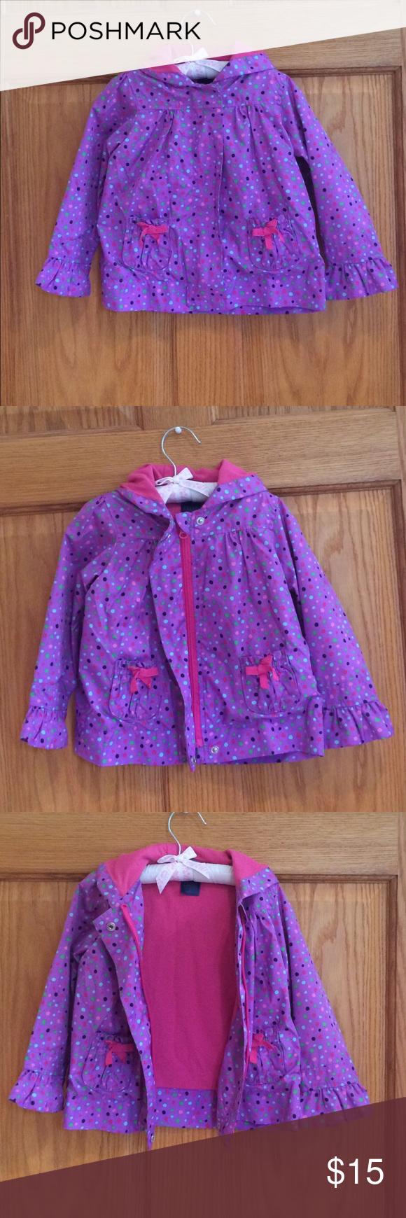 Falls Creek Spring Jacket Adorable, purple hooded jacket with colorful Polka dots and adorable ruffled sleeves. Two front pockets with cute bow detail. Zipper & two snap closures. Shell : 100% polyester and lining: 65% polyester and 35% cotton. Falls Creek Jackets & Coats