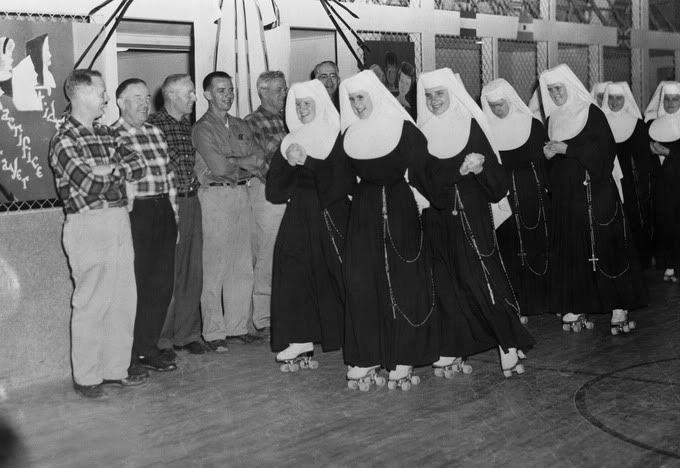 Roller skating nuns. Photographer: Elliott Erwitt.
