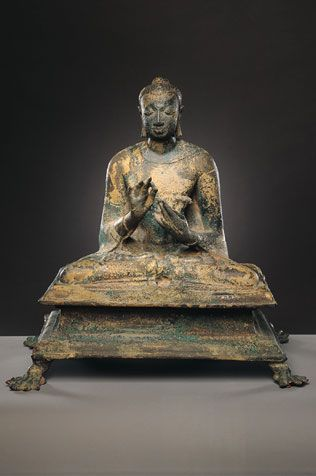 Buddha. India; Gupta period (c. 319 - 6th century), 6th century. Buddha sits in the posture of meditation with hands held in teaching gesture (dharmachakra mudra). A u-shaped fixture on the back of his head and two slots in the base were used to attach a large prahba to the sculpture.