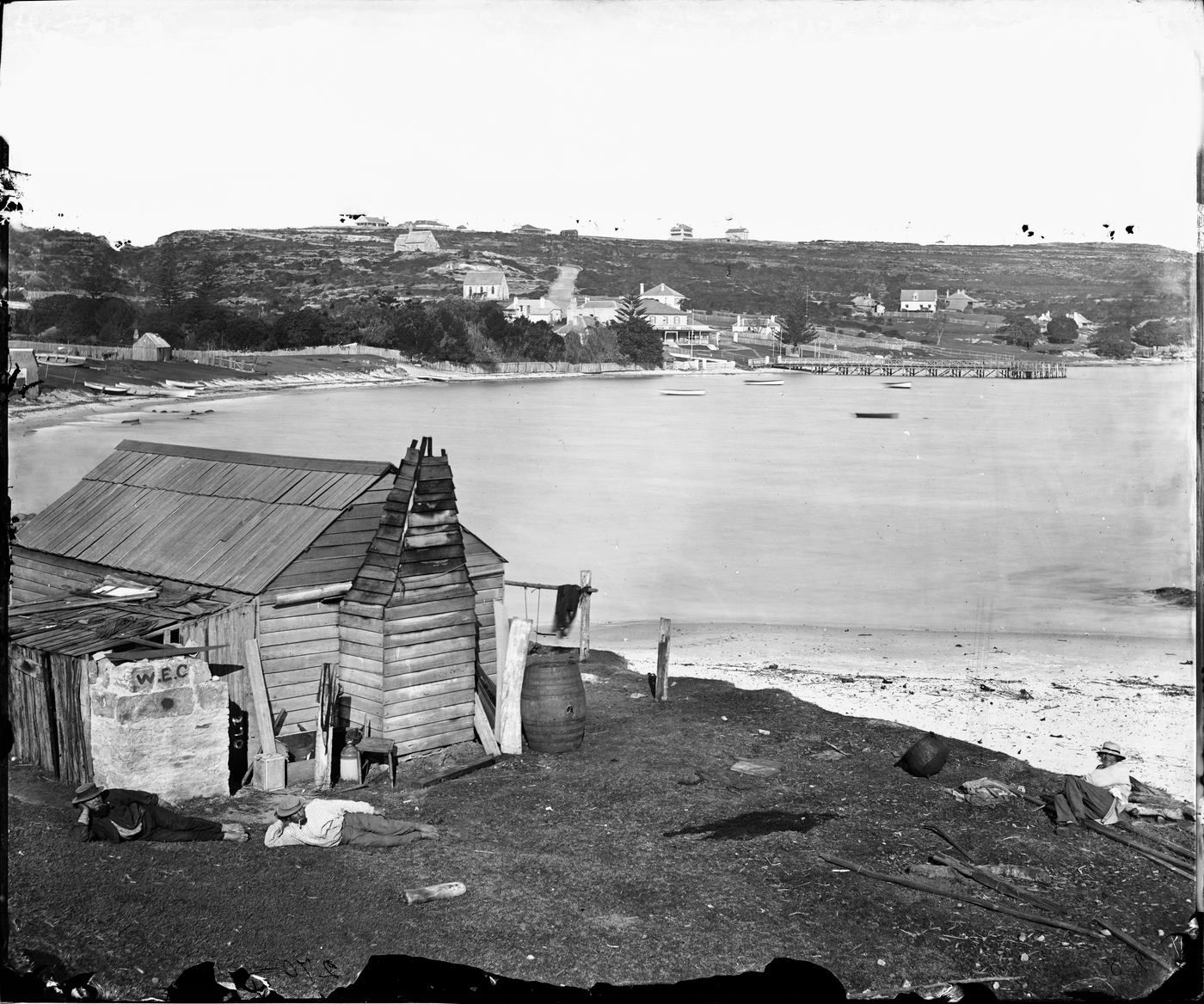 Slab hut on Village Point with Watsons Bay in the background
