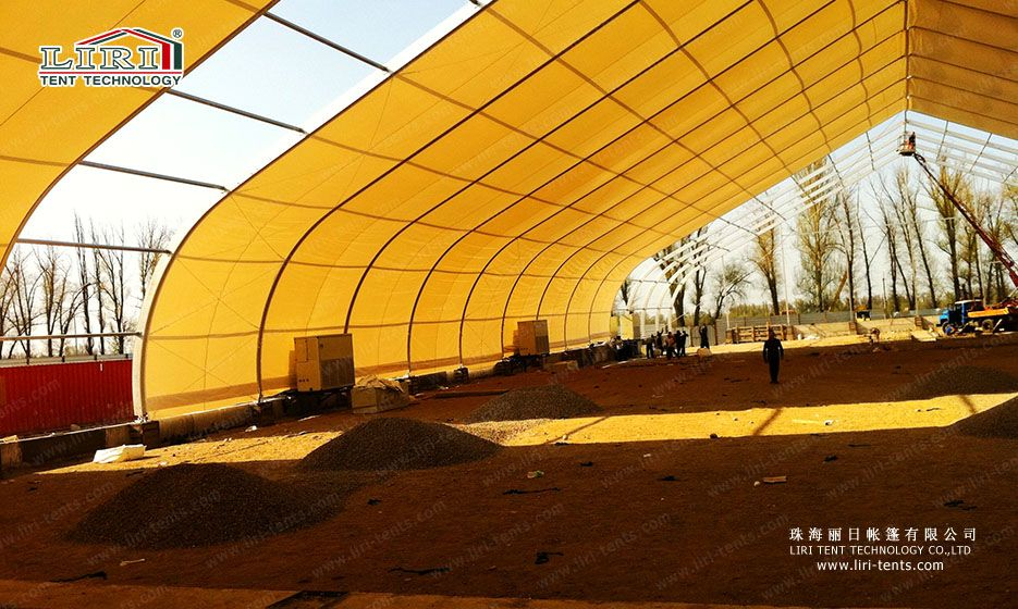 Erecting 40m span curve tent. If you are interested in more details, please contact me by tent@liri.cn or +86 1367 2679 064.