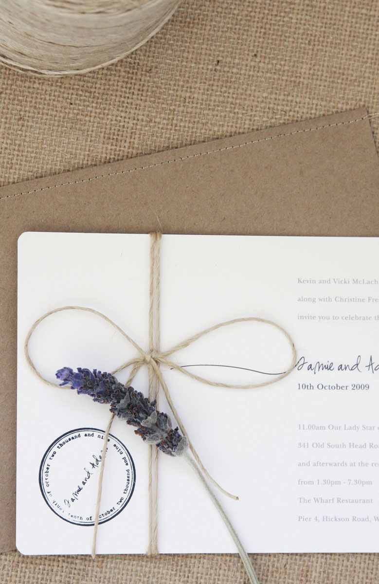 Twine tied invitations with a sprig of lavender.