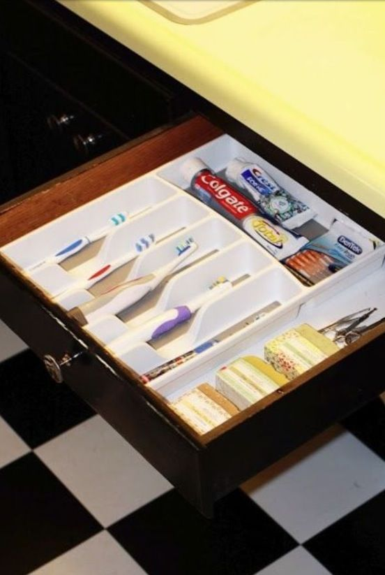 A sanitary way to organize your toothbrushes and keep the bathroom sink free of clutter. What a great idea!!