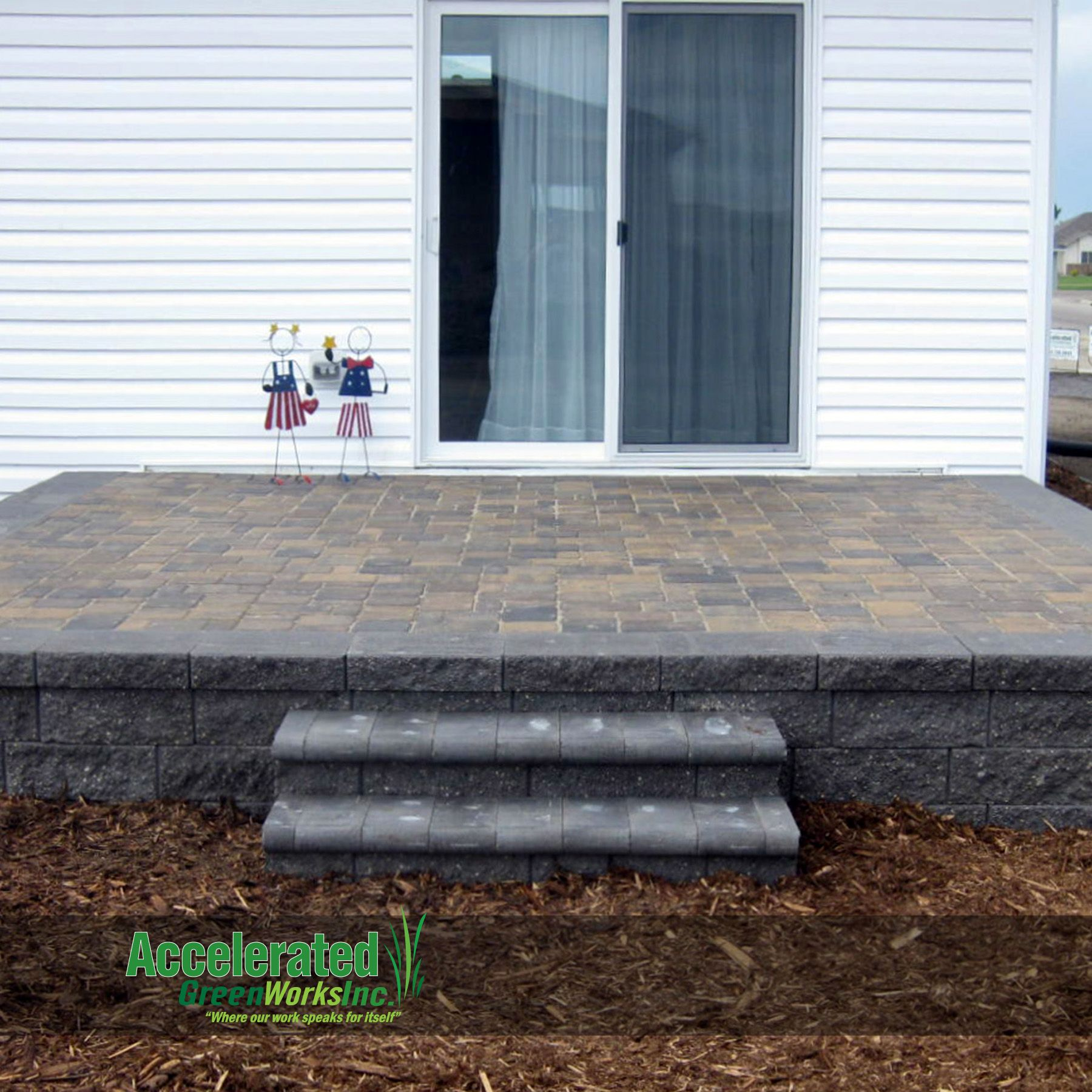 raised paver patio with steps to the landscaping versa lok block
