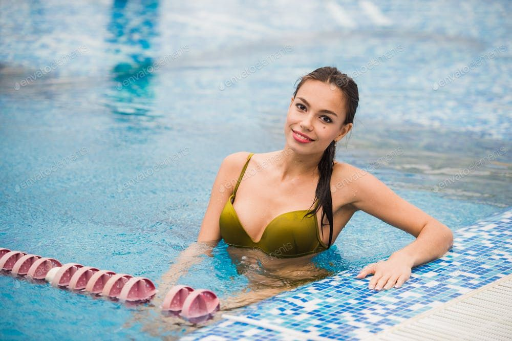 Beautiful Brunette Woman Relaxing At Swimming Pool Tanned Beauty Horizontal Photo By Romankosolapov On Envato Elements Brunette Woman Beautiful Brunette Woman Horizontal Photo Beautiful swimming pool eagle wallpaper