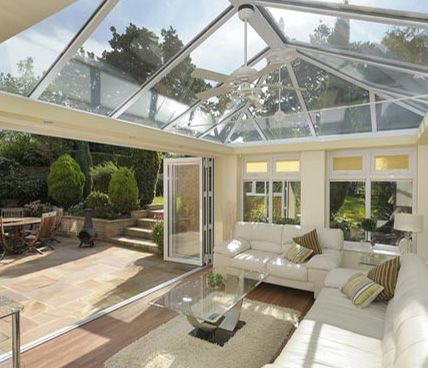 Orangery modern interior with open door orangeri for Orangery interior design ideas