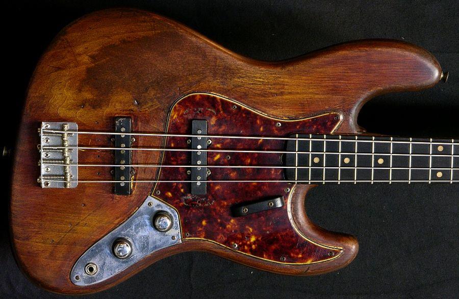 Raw, beat-up Fender Jazz bass. #beauty