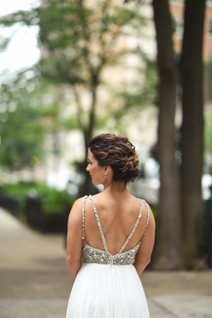 beautiful wedding updo + backless dress | hair by
