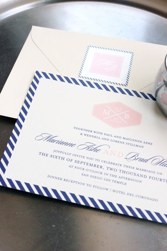 San Diego-inspired nautical striped wedding invitation in navy blue, blush pink, and cream, with maritime monogram. By Little Words Design. www.littlewordsdesign.com