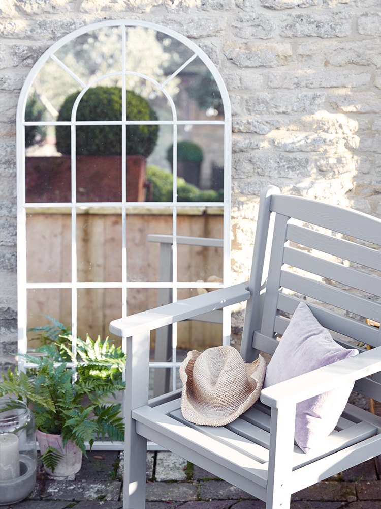 with its soft arched top and distressed soft grey finish this romantic mirror adds new dimension to your garden