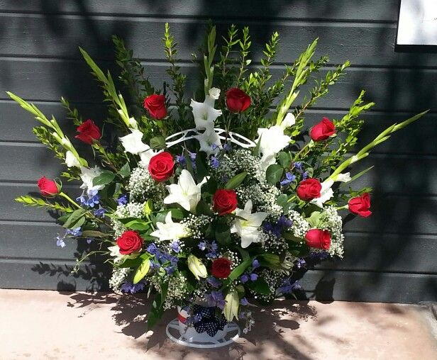 Red, white and blue funeral basket