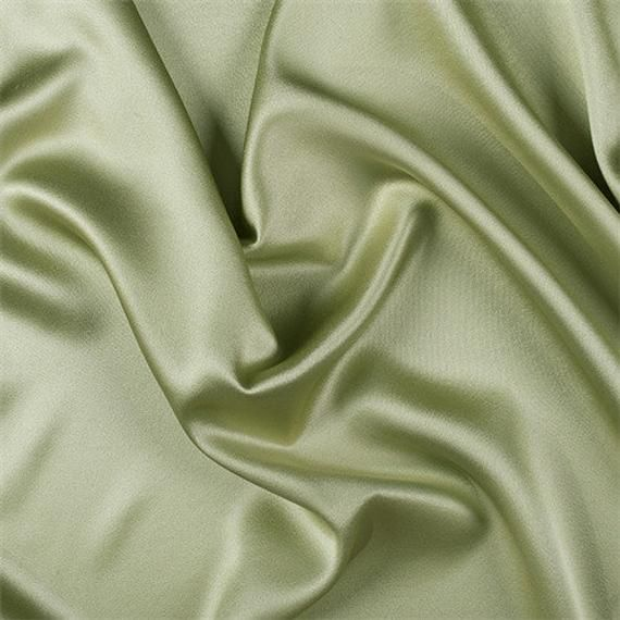 MATERIAL : 100% Silk BRAND : Fashion Fabrics Club COLOR : Green FIBER CONTENT : 100% Silk CALIFORNIA PROP 65 WARNING : FalseFashion Fabrics ClubCelery Silk Crepe Back SatinSolid Celery Green Silk Crepe Back Satin Fabric Top of the line silk with a high sheen, similar to charmeuse only heavier and more luxurious. Top side is shiny back side which is crepe has a fine rib and pebble look and feel. Both sides can be used for textural effects. A superb choice for bridal or the most elegant evening we
