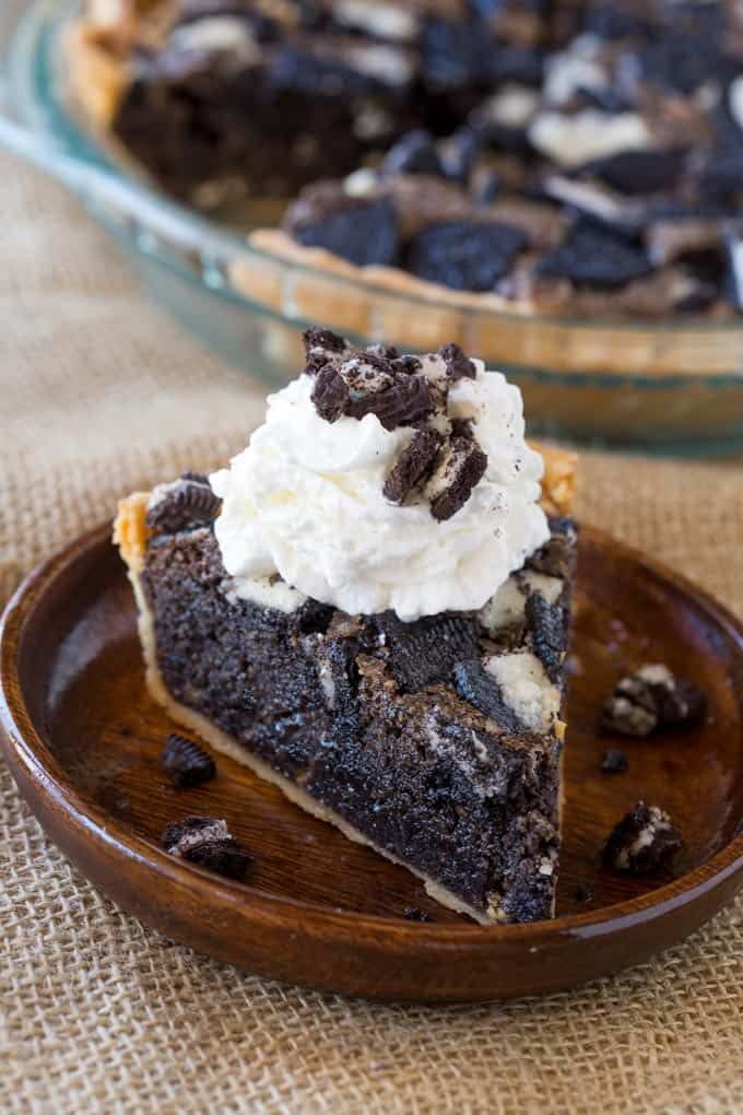 The Ultimate Oreo Pie that tastes like warm Oreo cookie baked into a buttery pie crust thats half pie and half cookie served best with vanilla ice cream