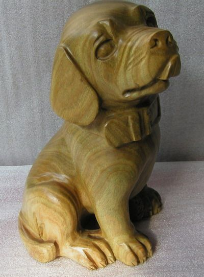 Tree wood carvings of dogs with free form patterns for