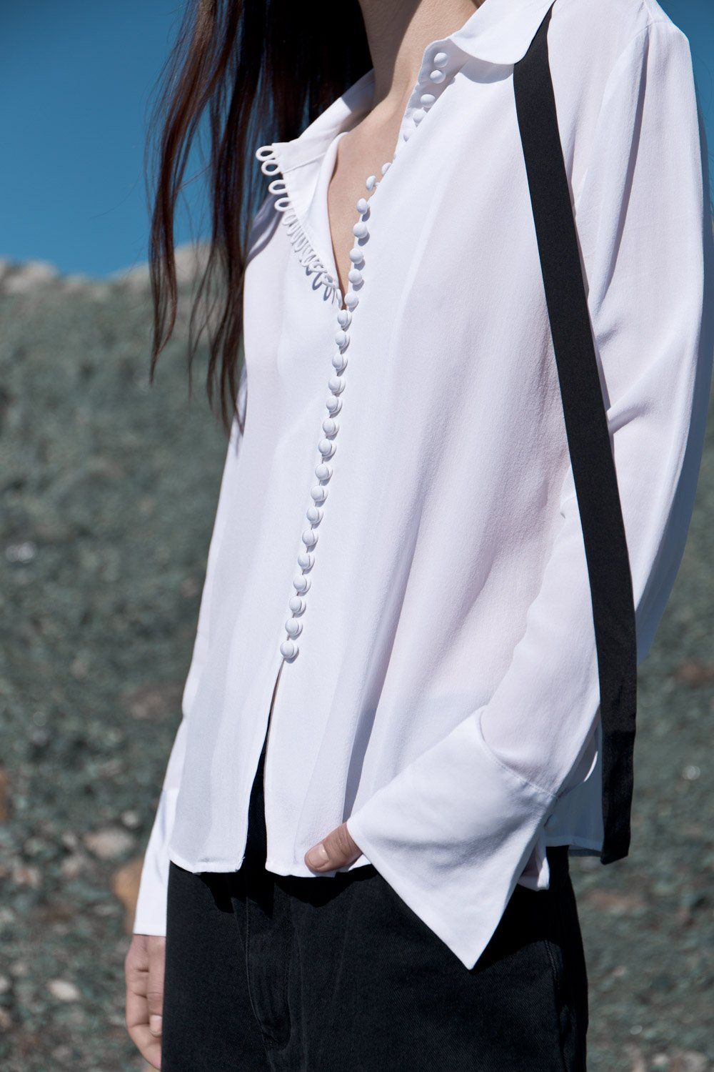 ca363b3f54be1 Long-sleeve silk shirt featuring covered looping button detail with  removable tonal bow tie at neck