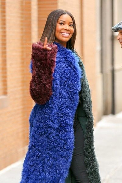 Actress Gabrielle Union is seen wearing a multi-colored fur coat while leaving 'The View' in New York City.