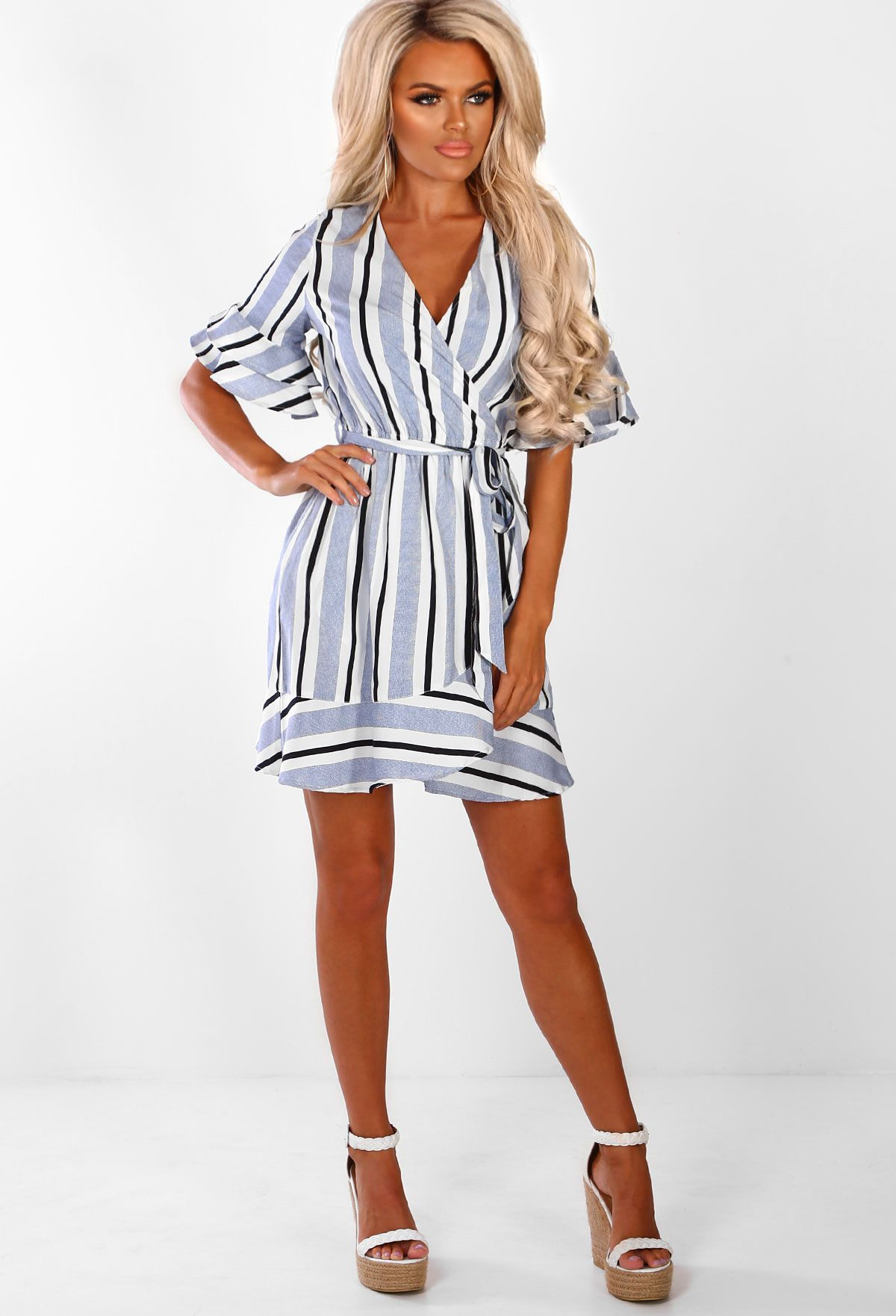 6652bf30273 Shop women s wrap dresses and day dresses at Pink Boutique - for a glam off  duty look shop stripe dresses and blue dresses now!