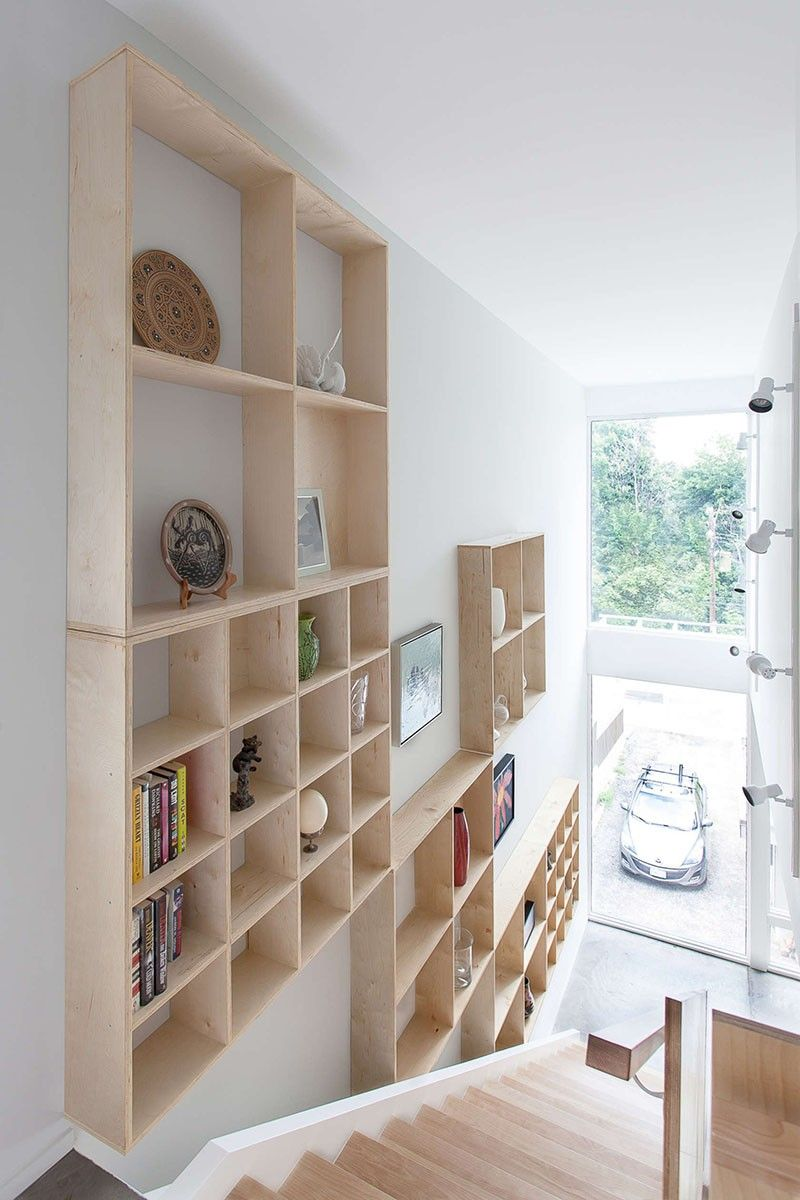 Stairs Shelves design detail – a grid of plywood shelves follow the stairs