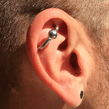 Other angle of the 10 Gauge Orbital Ear Cartilage Piercing ...
