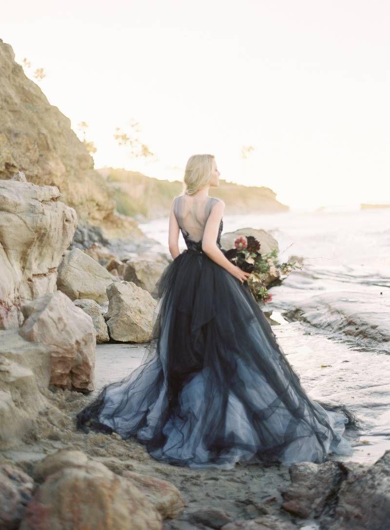 Sunrise beach wedding  Sunrise Beach Shoot with a stunning indigo gown via Magnolia Rouge